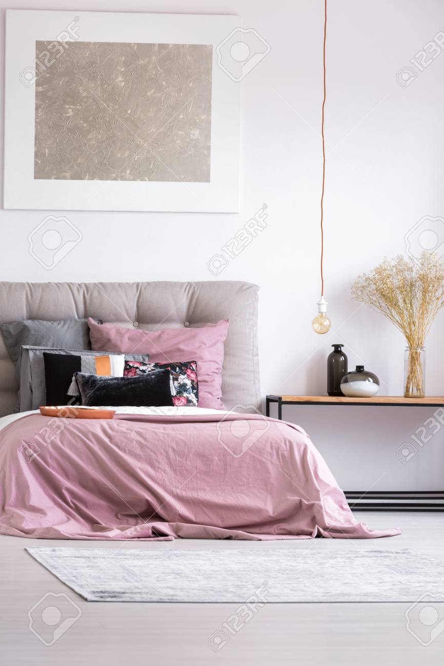 Decorative Vases On Table In Stylish Bedroom With Copper Plate And Pink  Bedsheets On King
