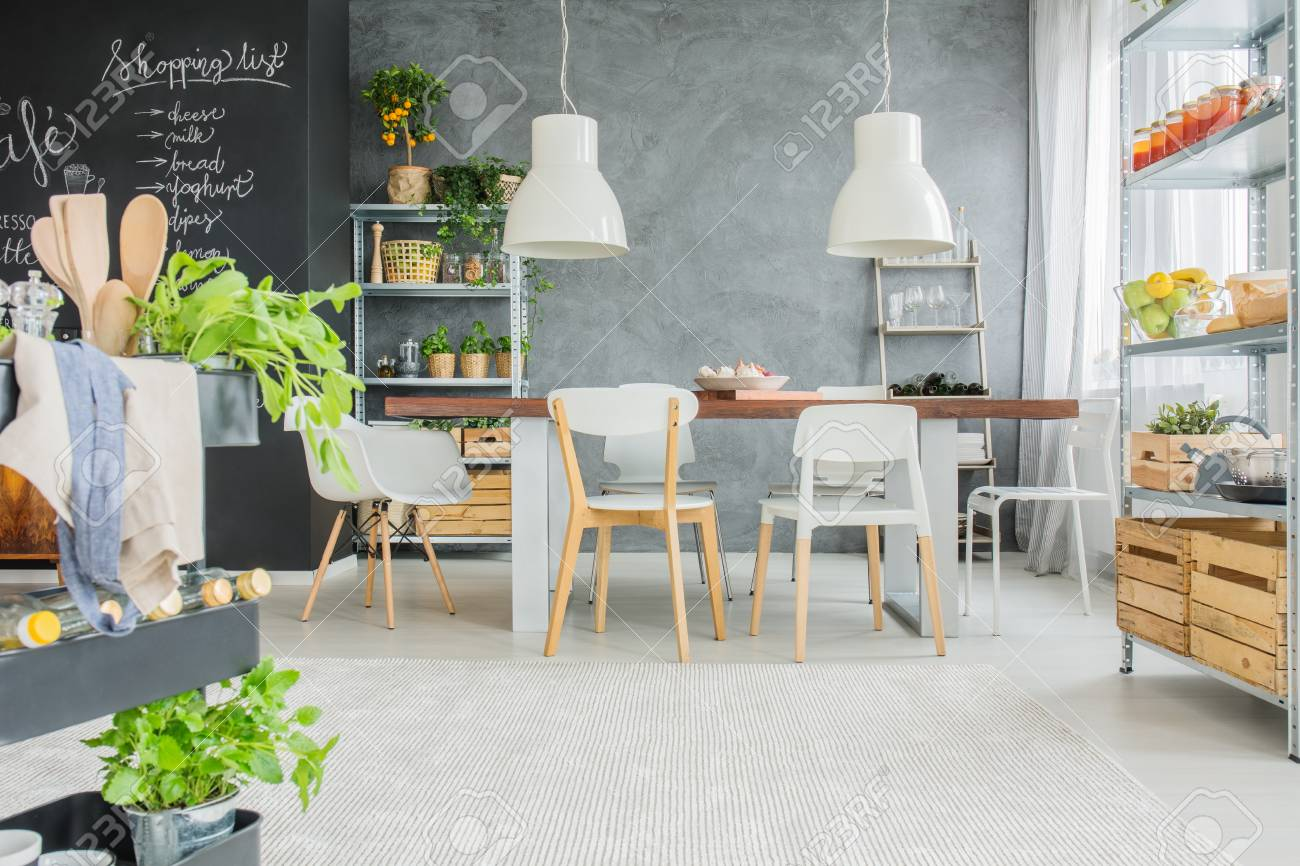 Industrial Dining Room With Big Communal Table And Chalkboard ...
