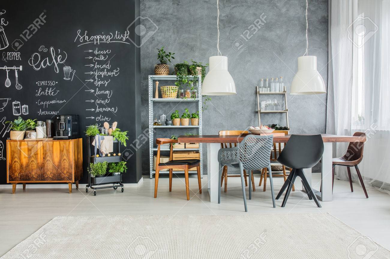 Chalkboard Accents And Mismatched Chairs In Eclectic Dining Room Stock  Photo   85134310