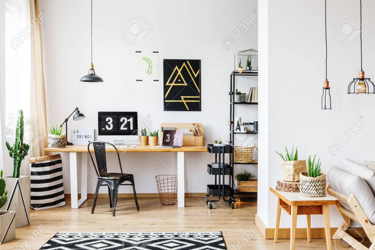 Trendy room with workspace for a freelancer with white wall,..