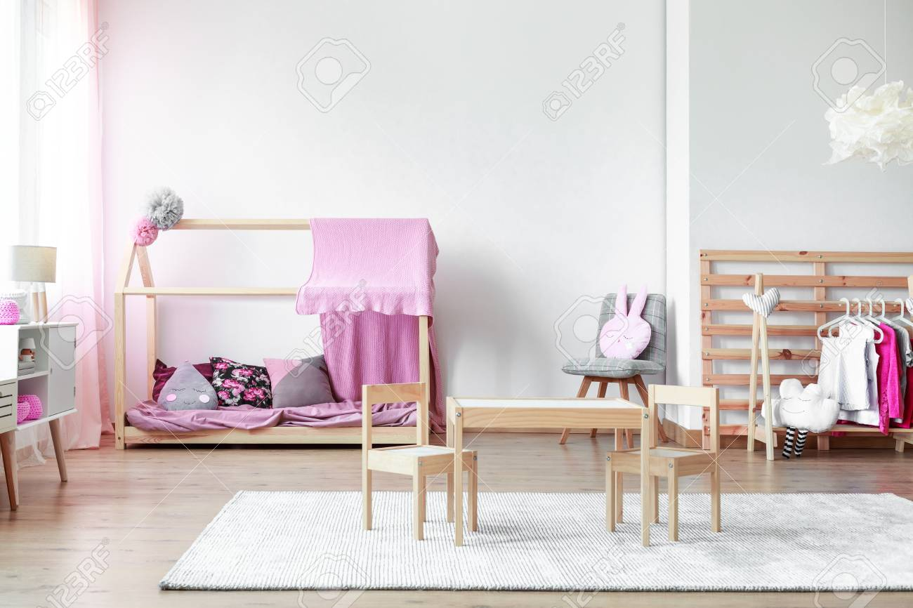 Small Wooden Table And Chairs On White Carpet In Girls Bedroom ...