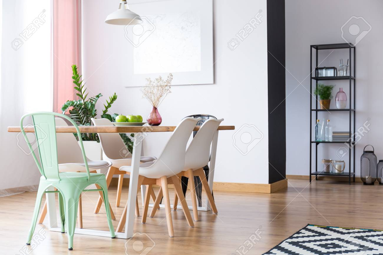 Lamp Above Table Under Window With Pink Curtain In Pastel Dining Room With  White And Mint