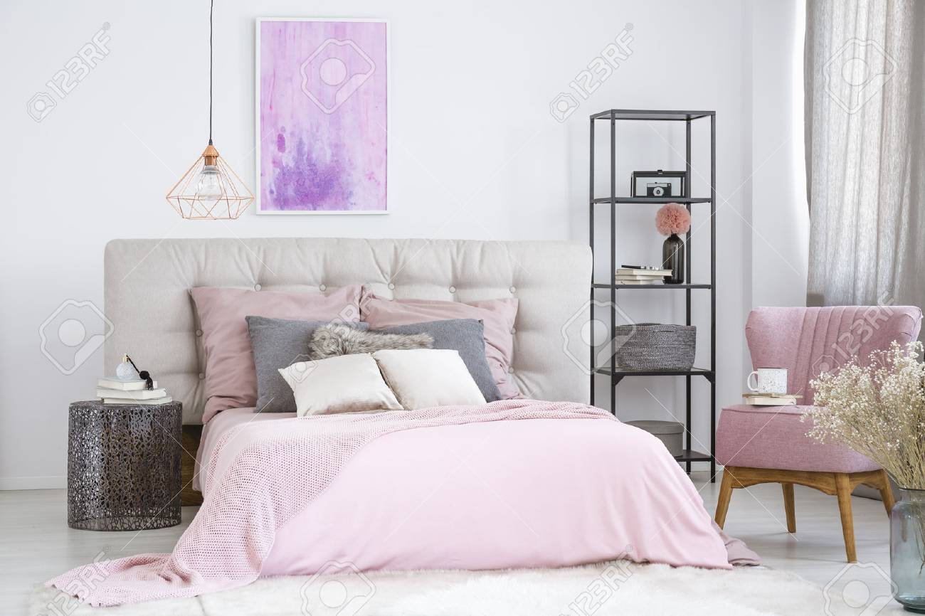 Metal Designer Nightstand Next To Wide Pink Bed And Black Industrial