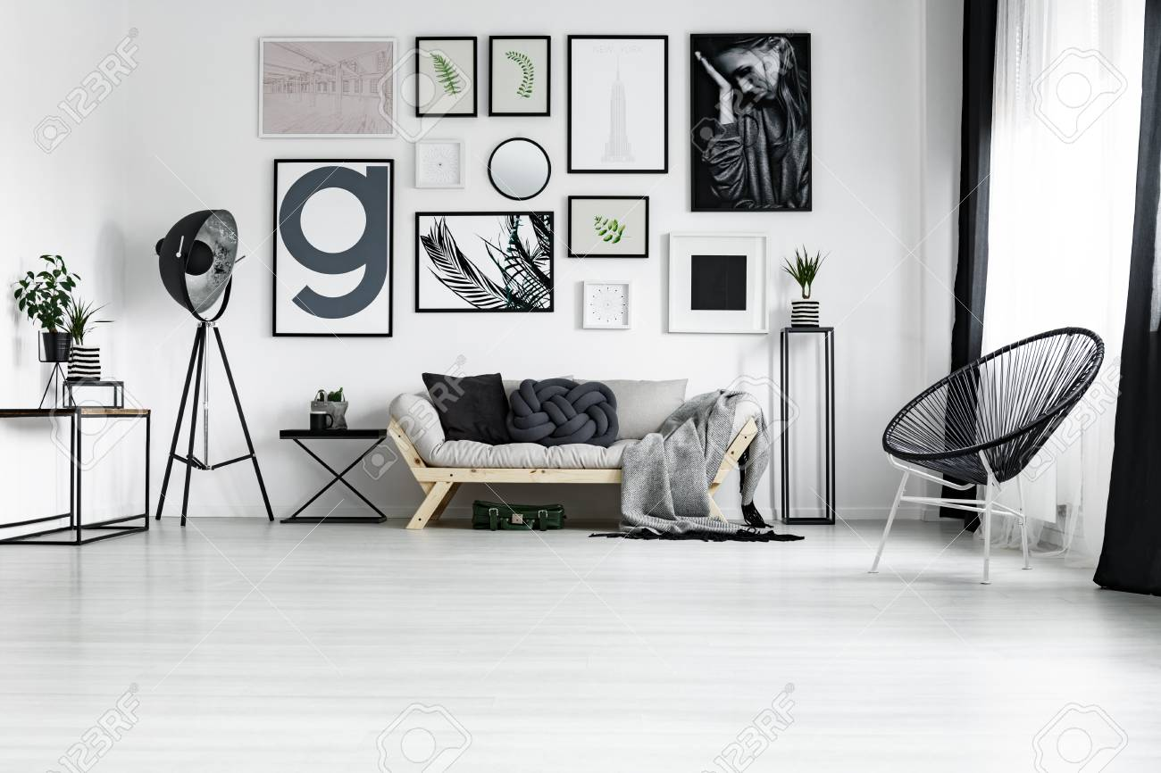 Dark Gray Handmade Cushion Lying On Bright Wooden Couch In Living