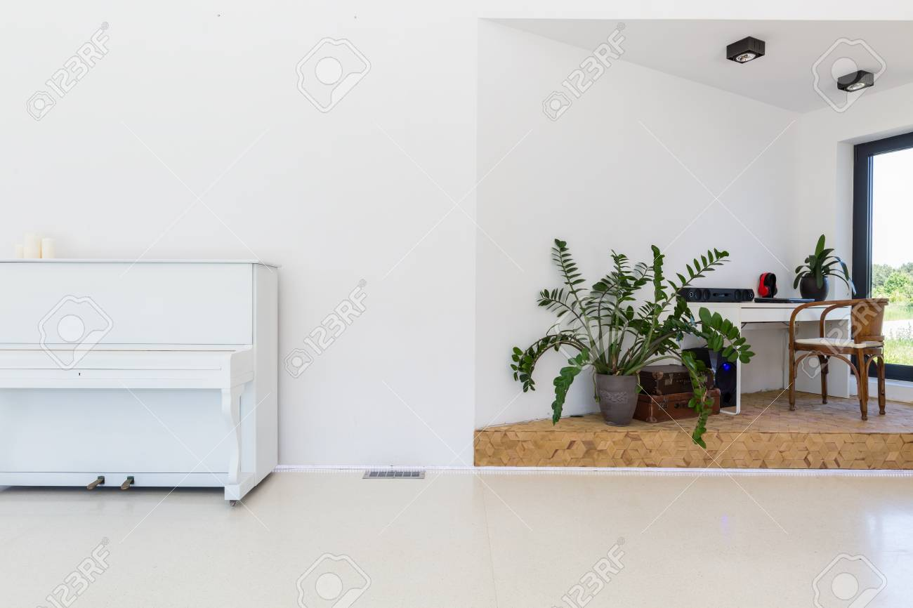 Part Of Bright Living Room With Piano And Working Corner With ...