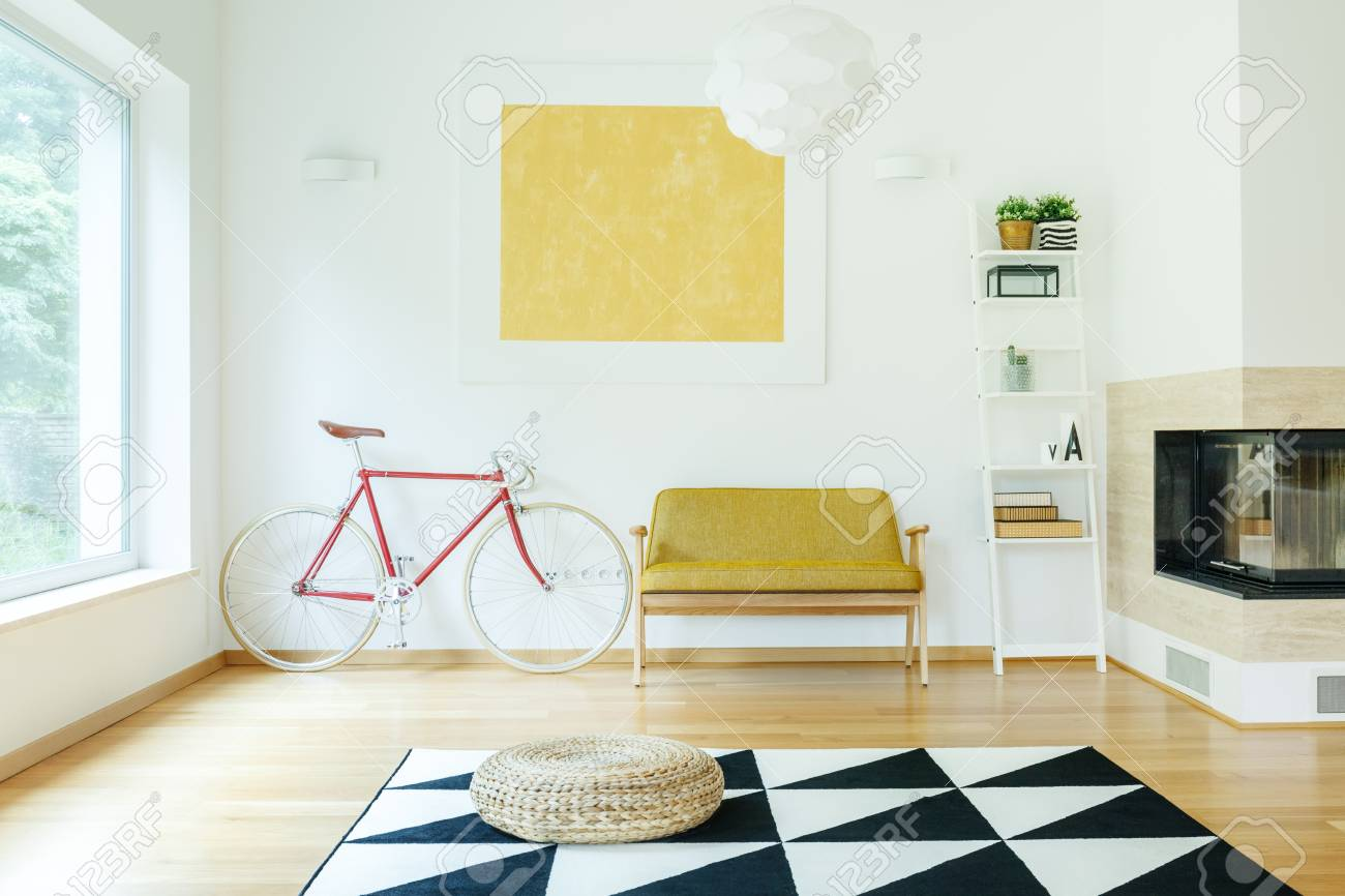 Yellow Sofa Between Red Bicycle And White Shelf In Cosy Living ...