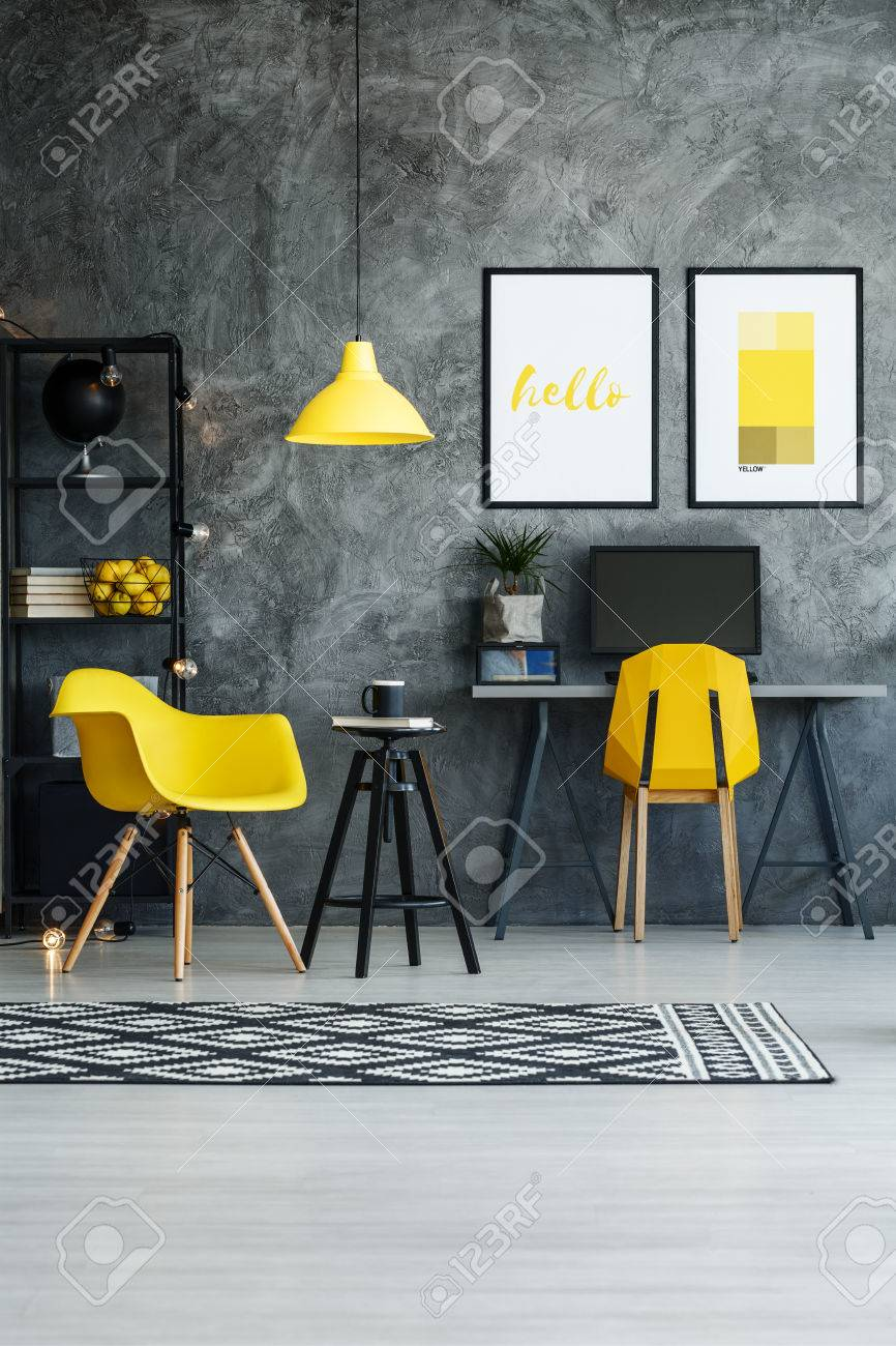 Yellow Chair And Designer Stool In Stylish Home Office With Posters ...
