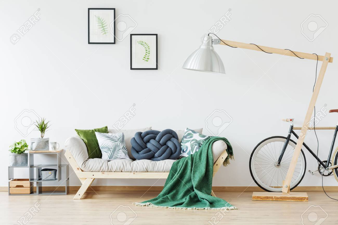 Simple Natural Design Of Modern Apartment With Wooden Sofa, Bike ...