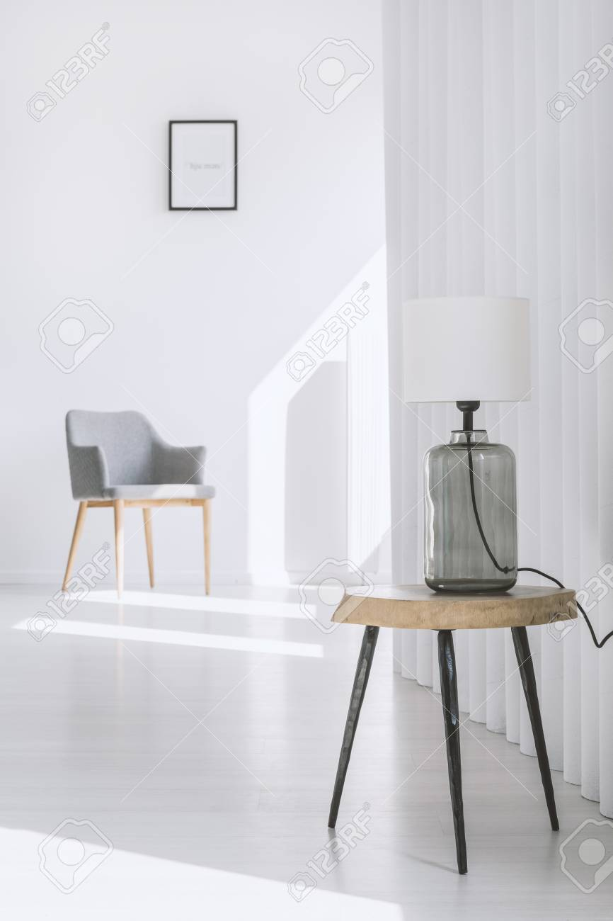 Pleasant Simple White Lamp Standing On A Wooden Stool In A Room With Minimalistic Gmtry Best Dining Table And Chair Ideas Images Gmtryco