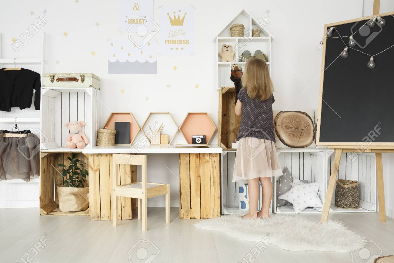 Wooden Chair At Diy Desk With Toys In Girl S Room With Clothes