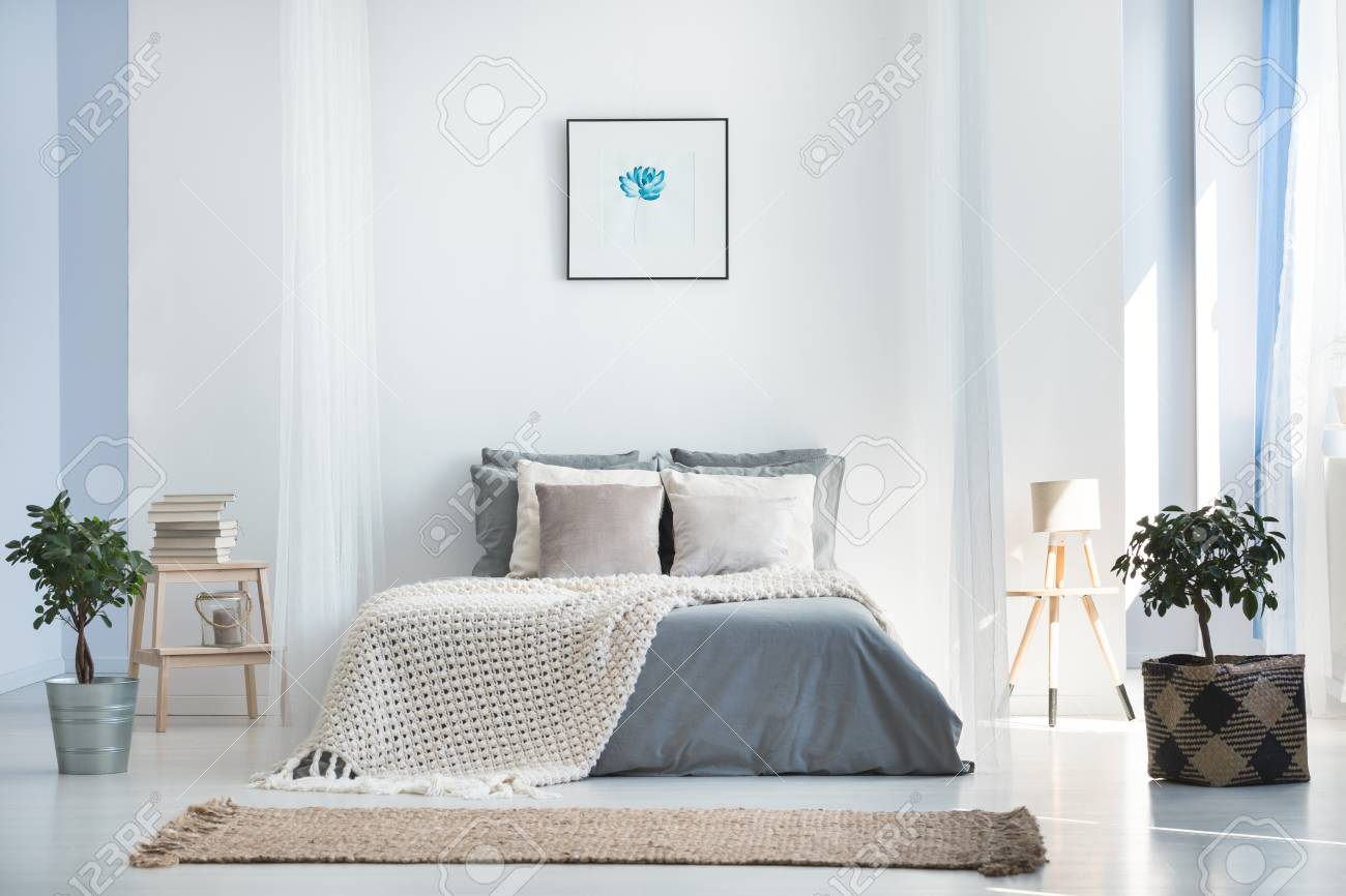 Beige Blanket On King Size Bed Against The Wall With Simple Painting Stock Photo Picture And Royalty Free Image Image 89250646