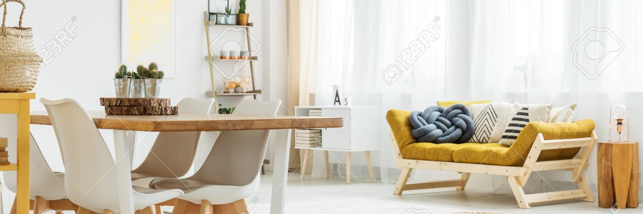 Modern accessories in cozy white living room connected with dining..