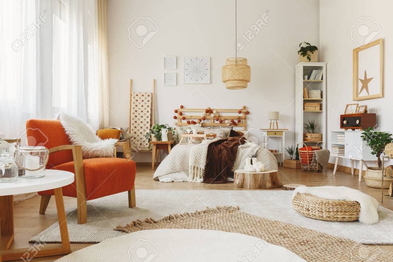 Fully furnished Scandinavian bedroom with a lot of rugs, chair,..