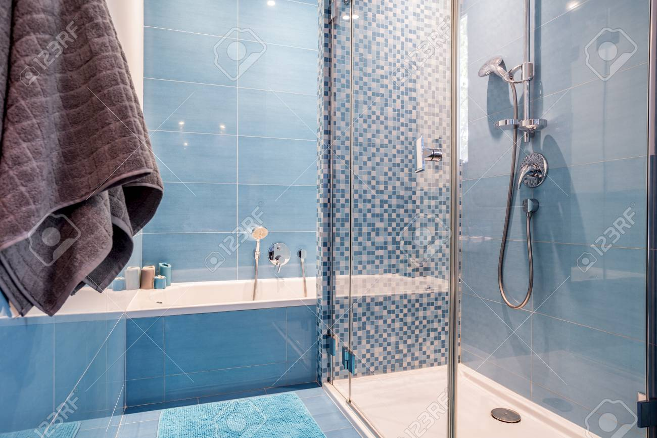Glass Shower And White Bathtub In Blue Bathroom With Patterned ...