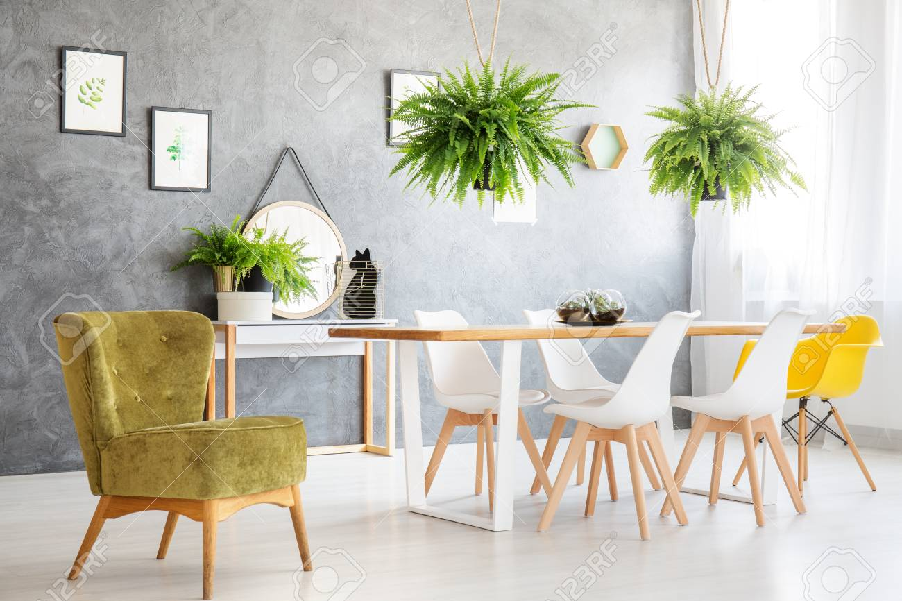 Green Vintage Armchair Next To The Table With White And Yellow Stock Photo Picture And Royalty Free Image Image 88256183