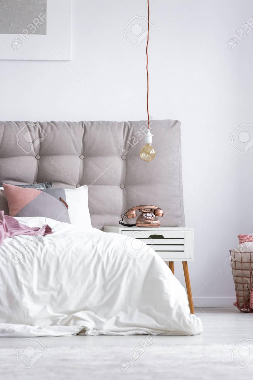Gray and white decor in scandi bedroom decor with trendy metallic..