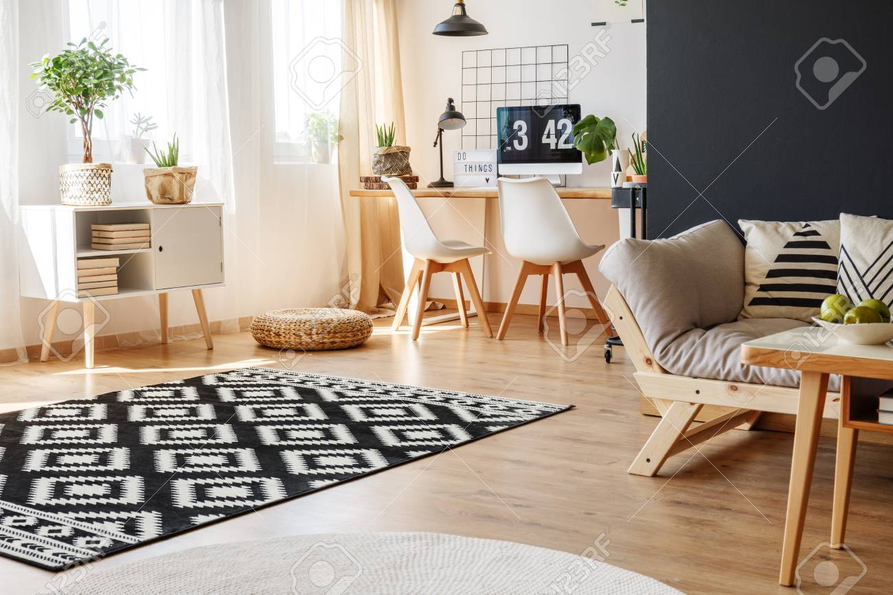 Black And White Carpet And Beige Sofa In Multifunctional Living Stock Photo Picture And Royalty Free Image Image 88566525