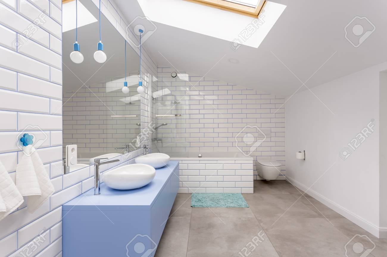 Simple Bathroom In The Attic With Blue Washbasin Cabinet, Toilet ...