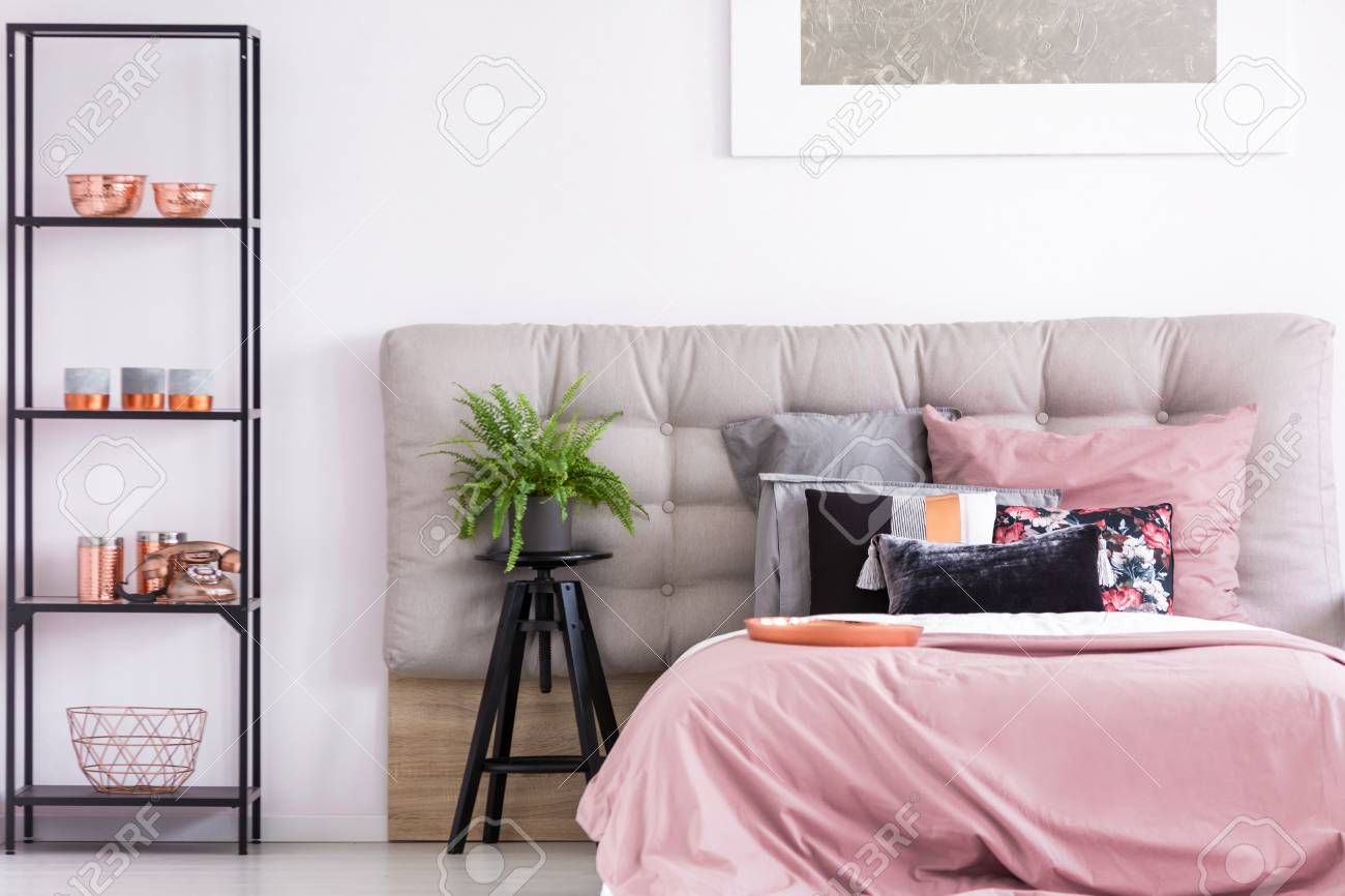 Trendy Interior Of Cozy Bedroom With Copper Accessories On Black ...
