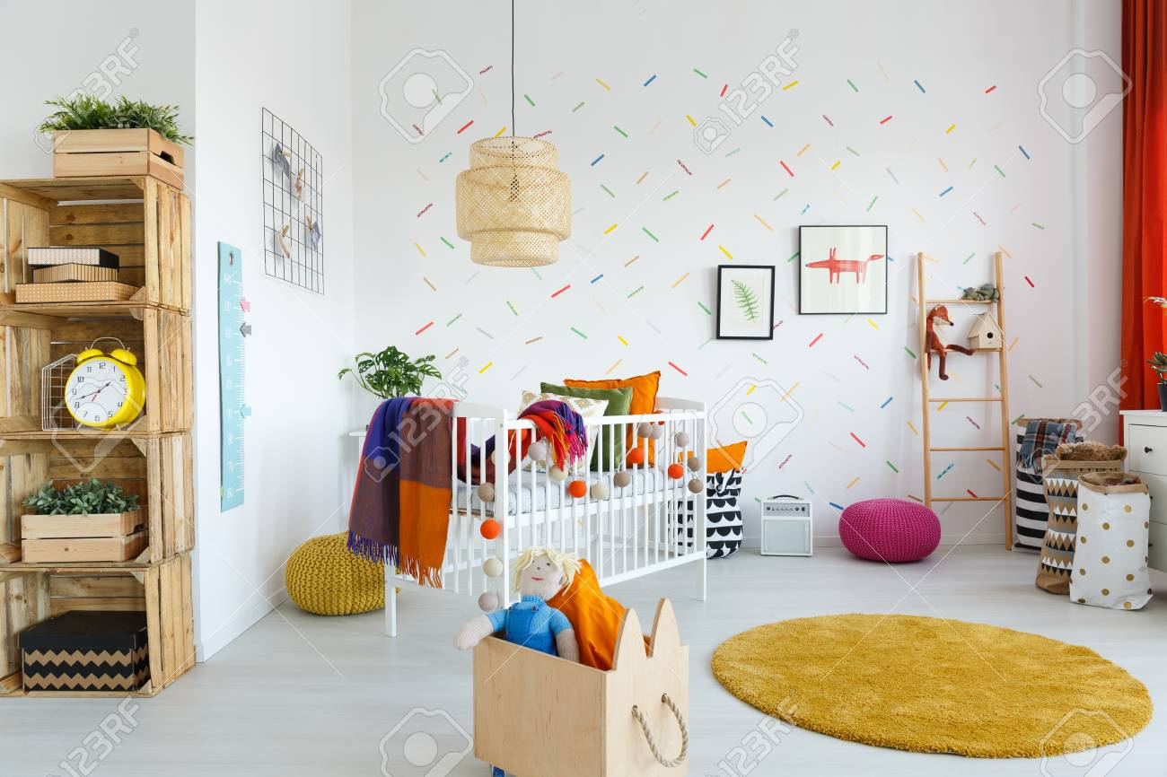 Toys In Wooden Box Next To Yellow Carpet In Scandi Baby\'s Room ...