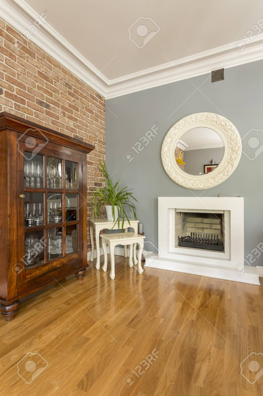 Decorative Mirror Above Fireplace In Open Space With Wooden Cabinet Stock Photo Picture And Royalty Free Image Image 88820738