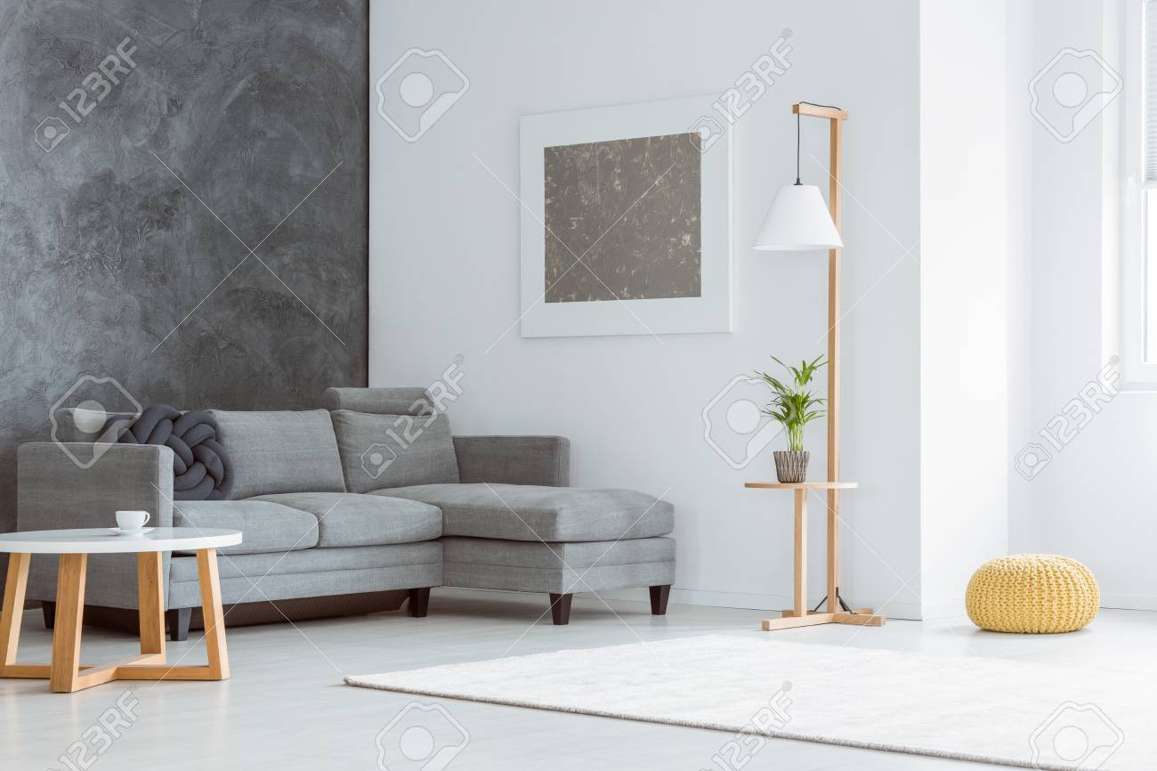 Side Angle Of White Minimalist Living Room With Gray Accents ...
