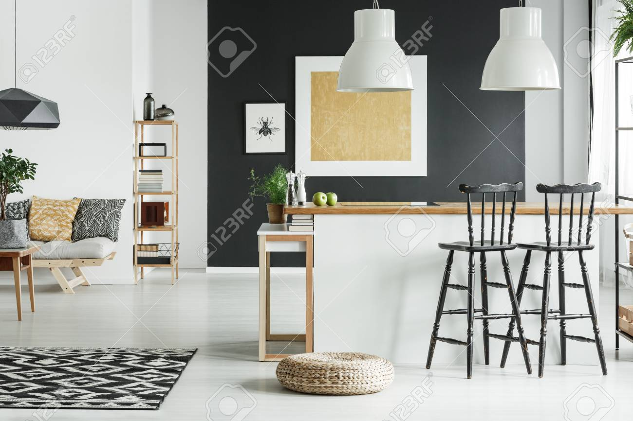 Pouf On The Floor Near Kitchen With Bar Stools And Patterned.. Stock ...