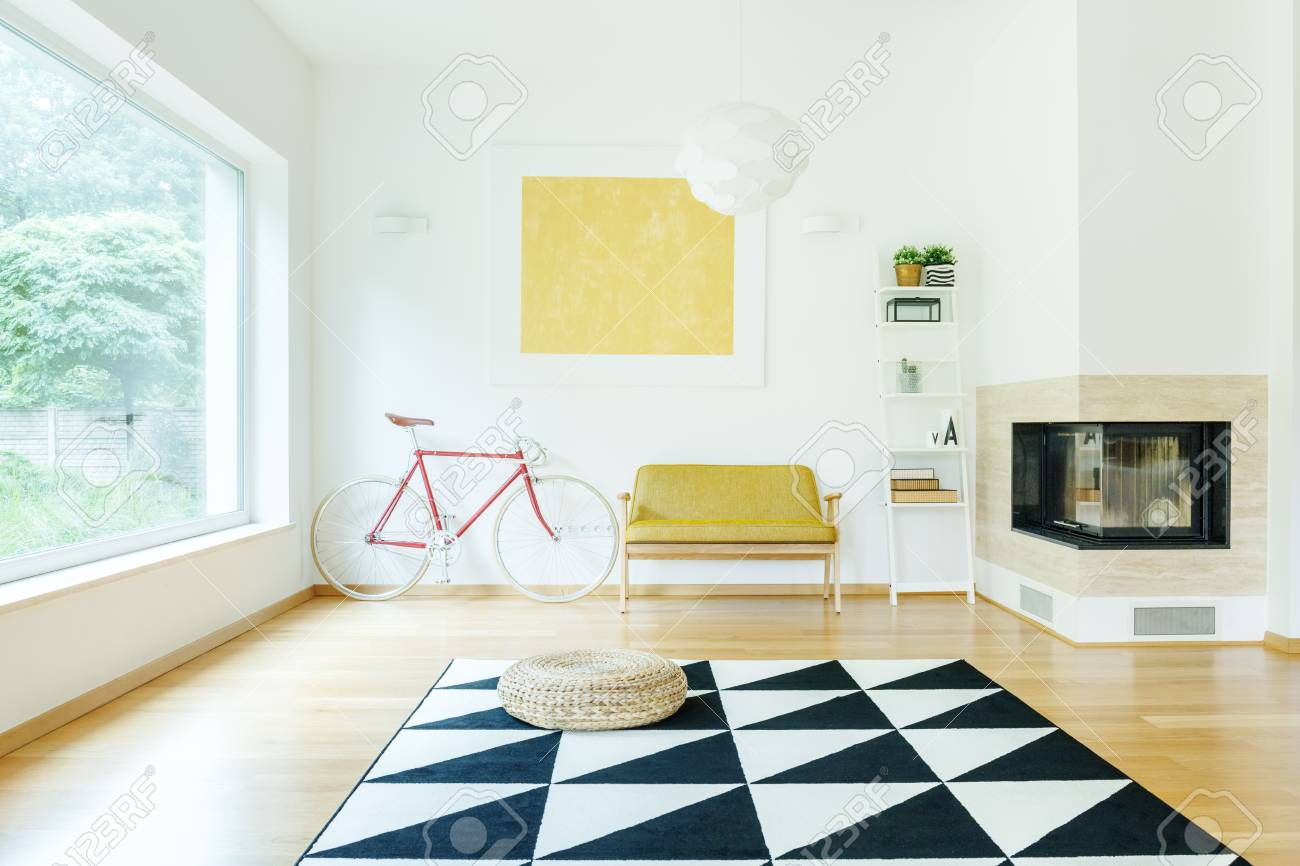 Pouf On Triangle Carpet In Bright Living Room With Fireplace.. Stock ...