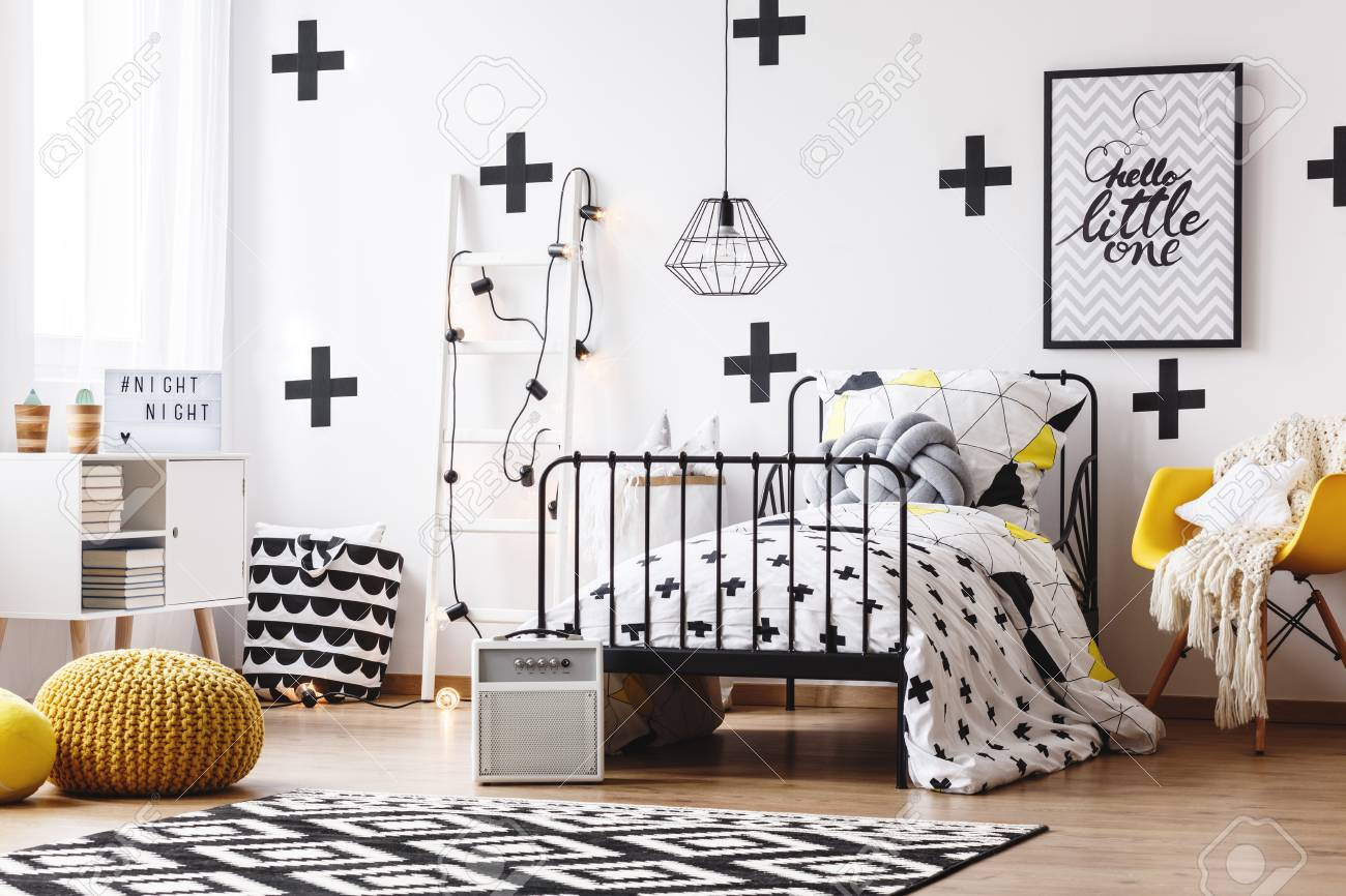 White wallpaper with black crosses in kid\'s bedroom with ladder,..