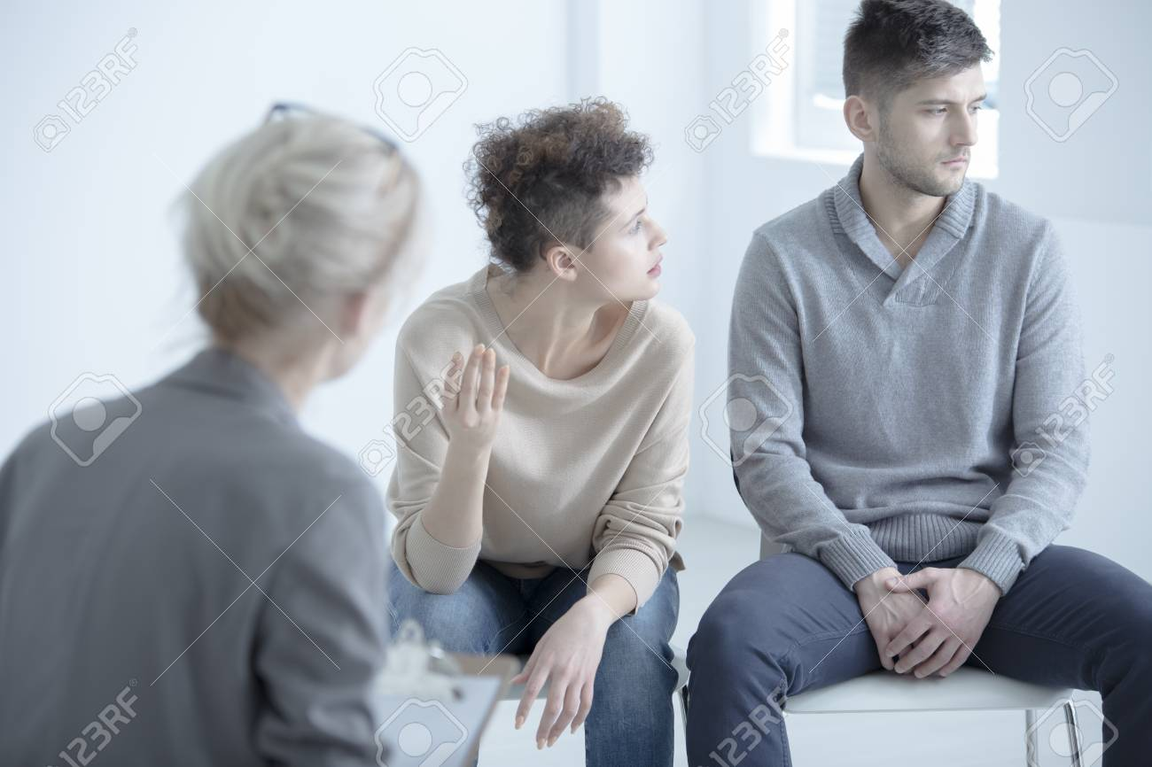 Wife Arguing With Her Husband During Marriage Therapy With Couple