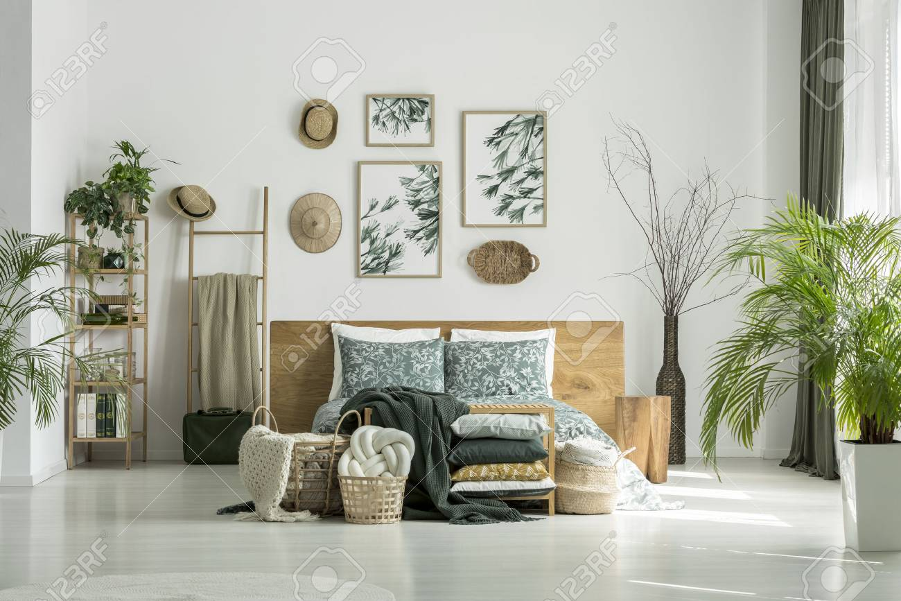 Posters And Hats On White Wall Above King Size Bed In Traveler S Stock Photo Picture And Royalty Free Image Image 90600490