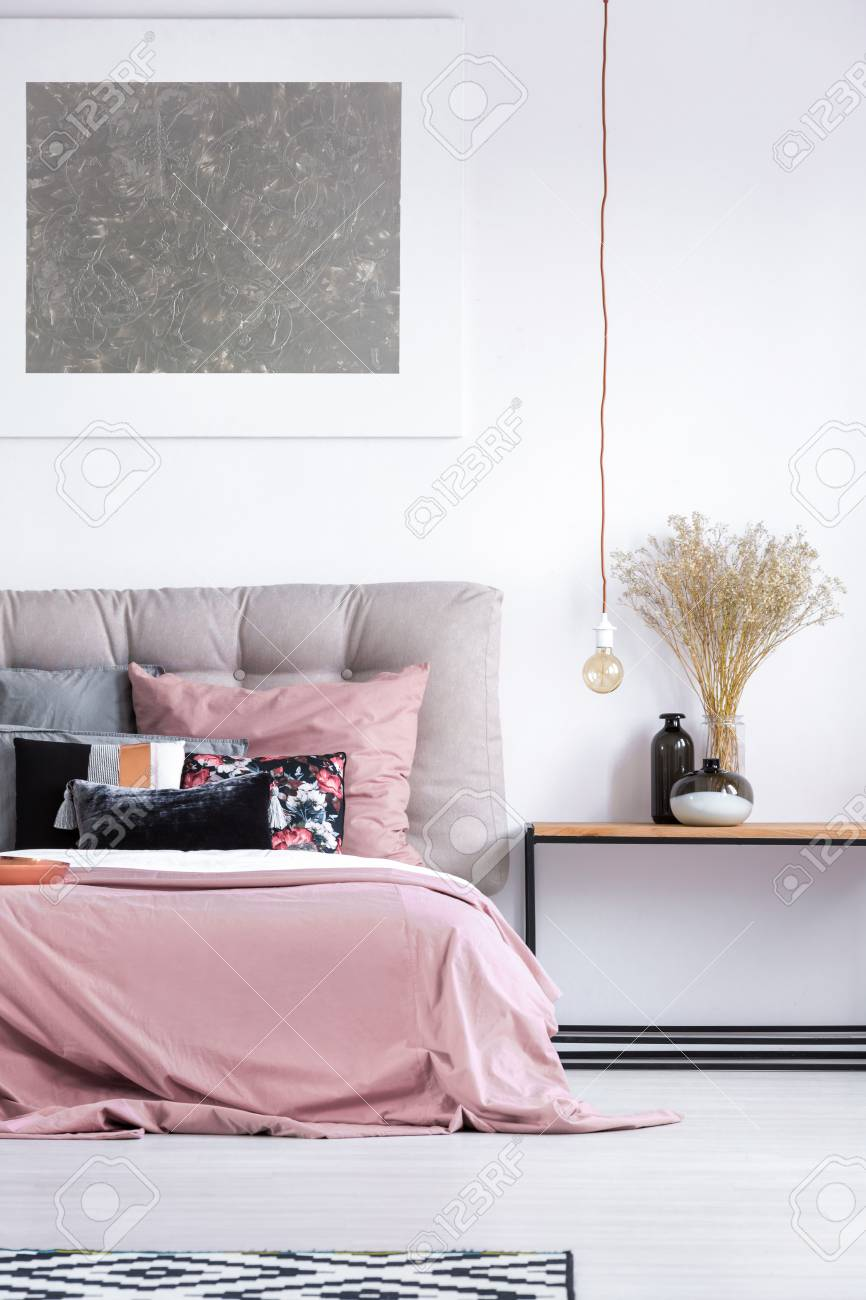 Silver Painting Above King Size Bed With Gray Headboard And Pink Bedding In  Cozy Interior
