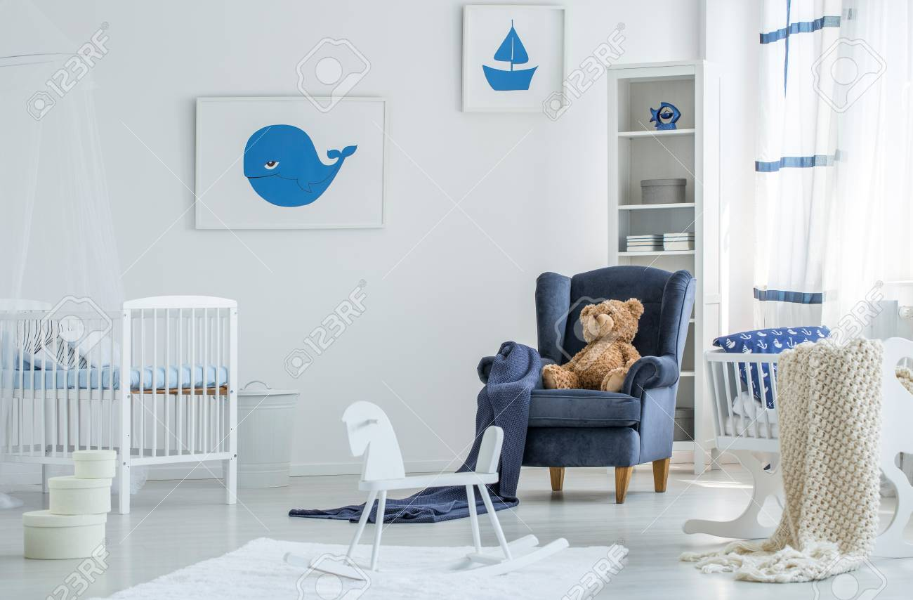 Plush Toy On Blue Armchair In White Child S Room With Rocking