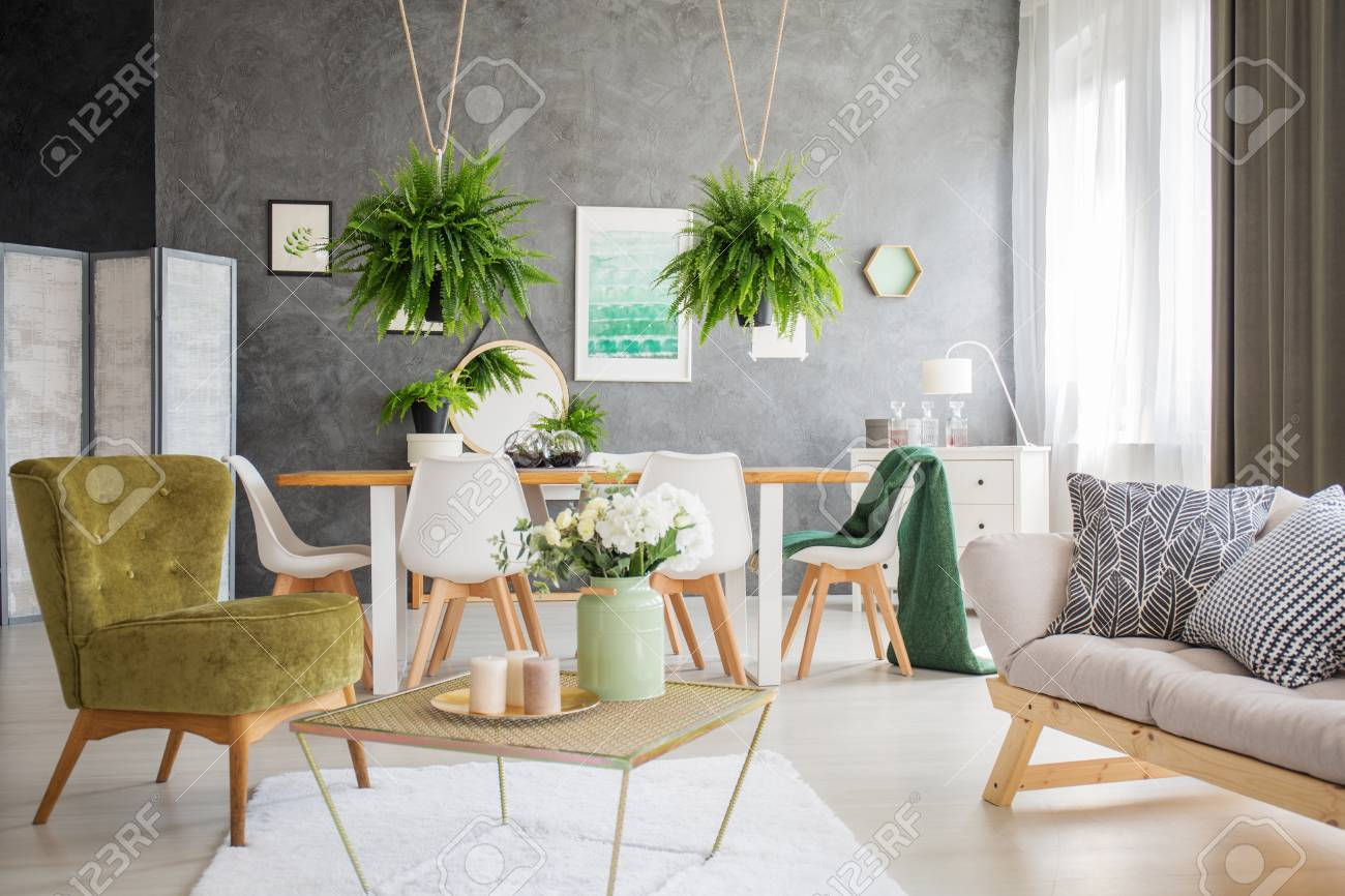 Green Chair And Grey Sofa With Pillows In Living Room Interior Stock Photo Picture And Royalty Free Image Image 89820073