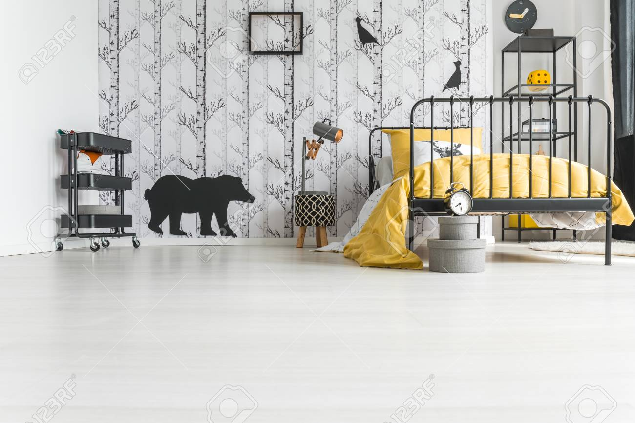 Poster On Easel And Yellow Lamp Above Carpet In Bright Kids Room With Plant And Clock Real Photo Stock Photo Download Image Now Istock