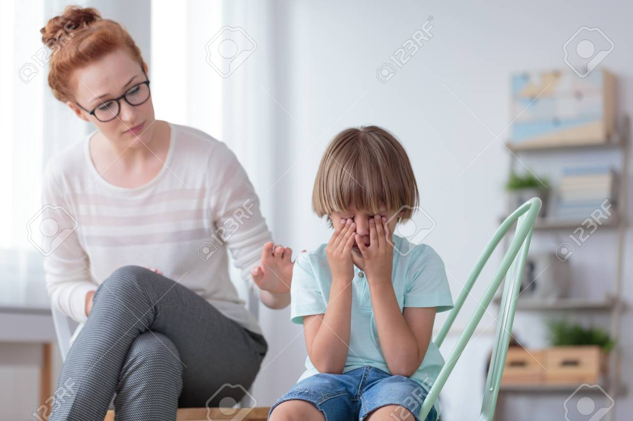 Parenthood and child development, young worried mother comforting little son crying at home - 89908684