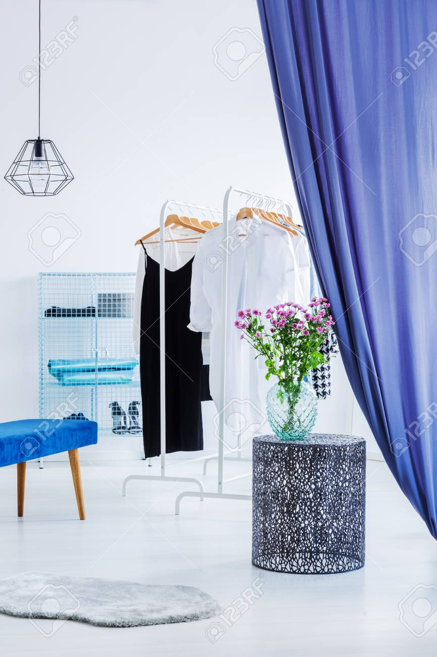 Elegant Clothes In White Modern Closet Behind Blue Curtains Stock Photo Picture And Royalty Free Image Image 97989943