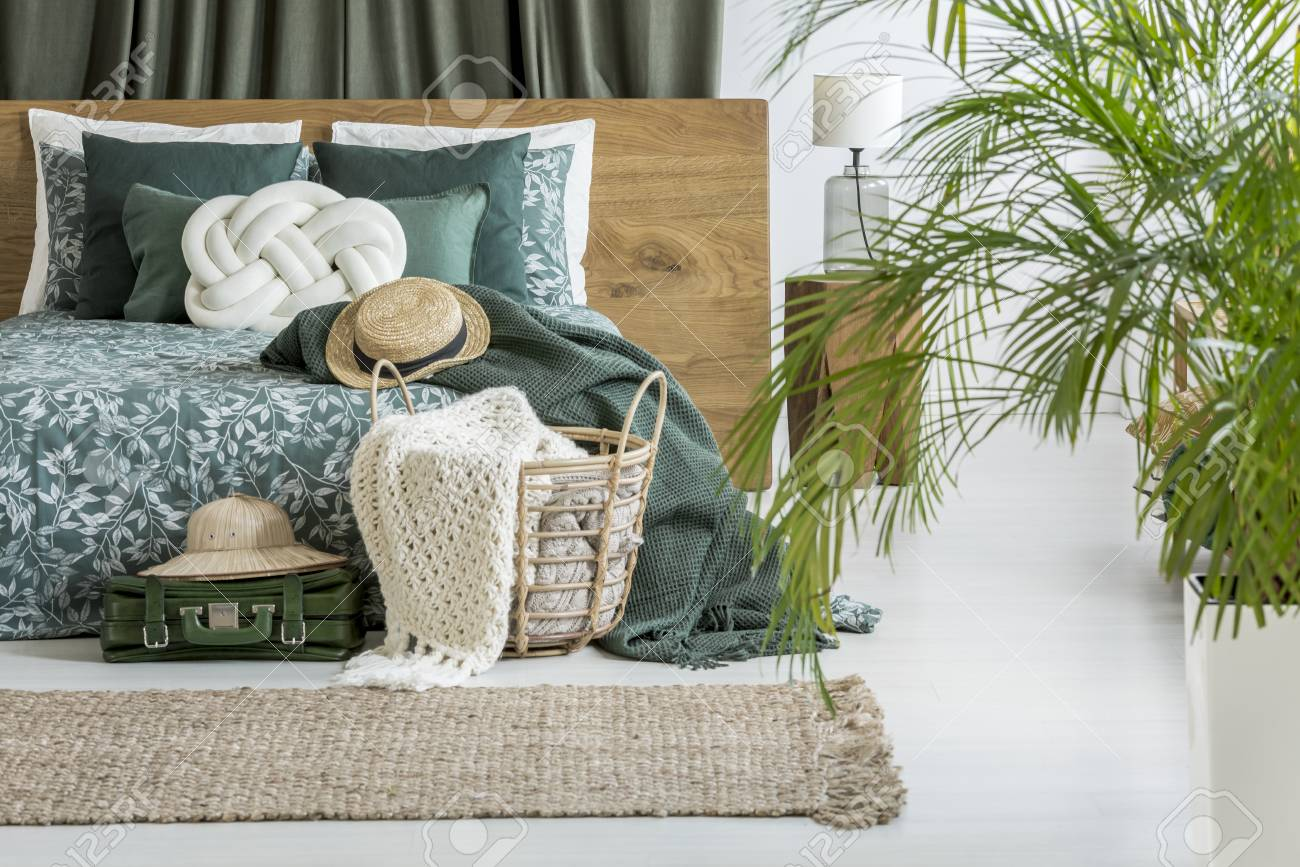 Blanket In Basket And Hat On Luggage Next To King Size Bed With Stock Photo Picture And Royalty Free Image Image 90217351