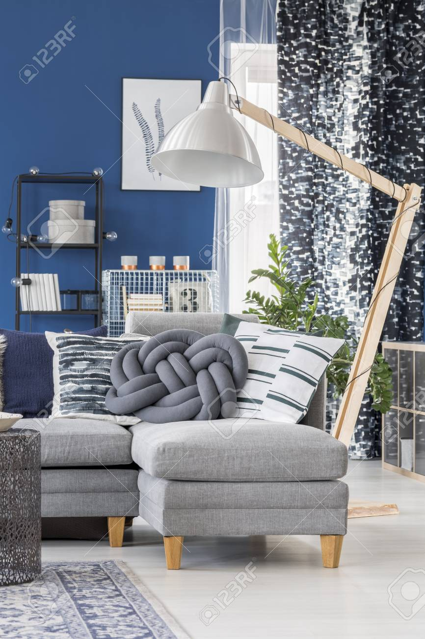Image of: Blue Apartment With Big Wooden Lamp And Decorative Pillows On Stock Photo Picture And Royalty Free Image Image 90323669