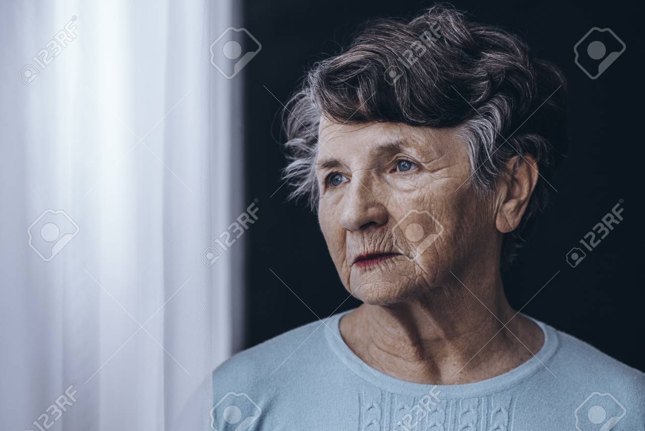 Elderly woman with memory problem spending time in nursing home - 90323723