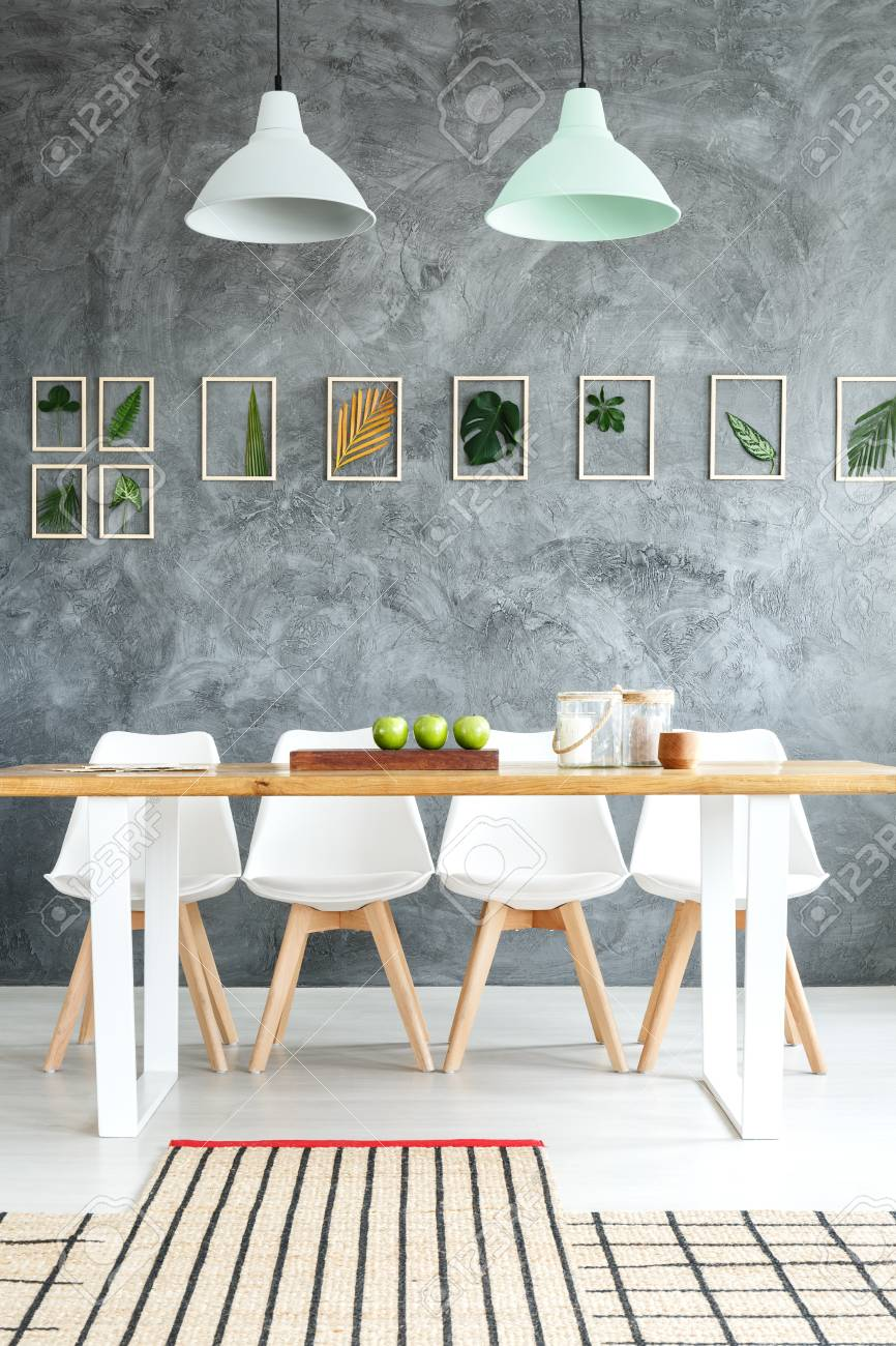 White Designer Chairs At Wooden Table In Contemporary Dining