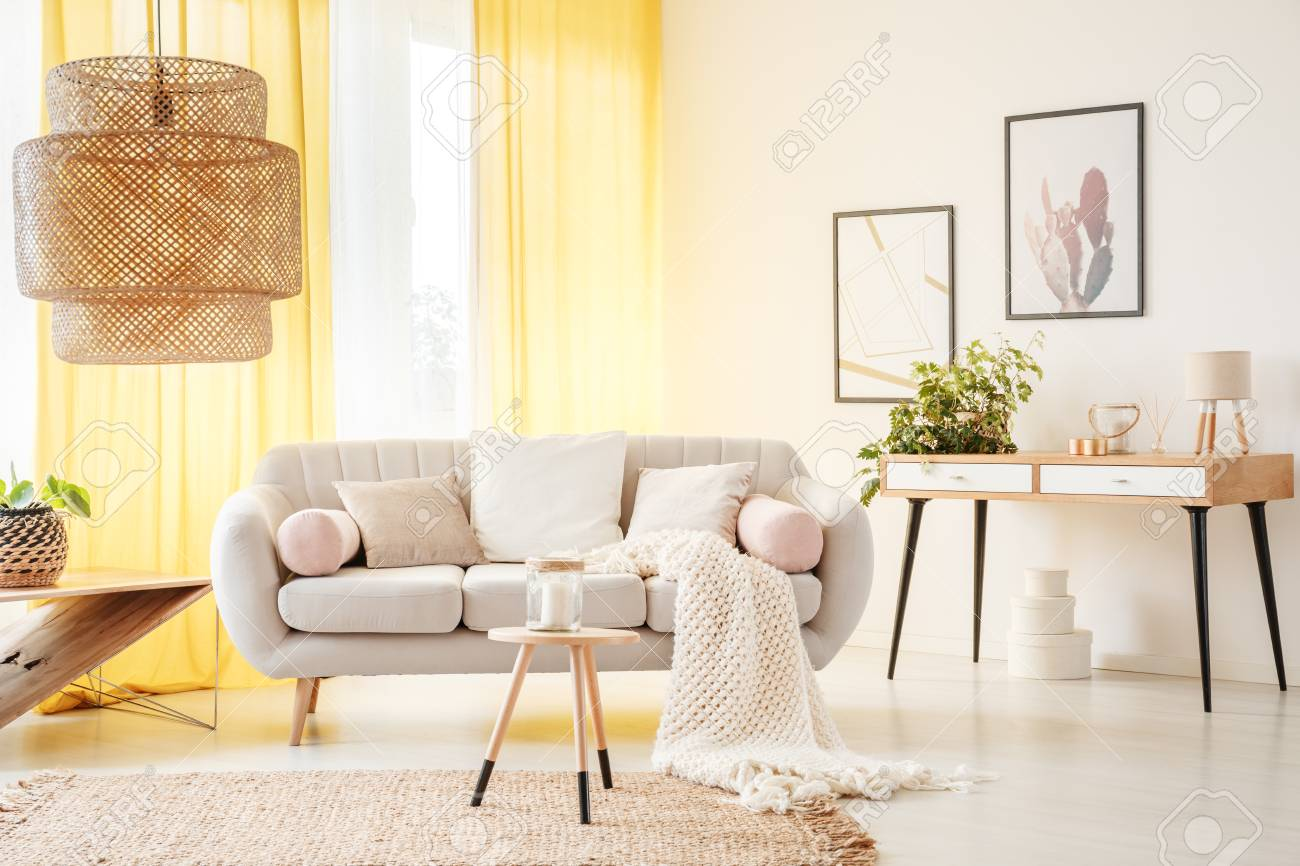 Rattan Lamp And Wooden Stool On Carpet In Warm Bohemian Living ...