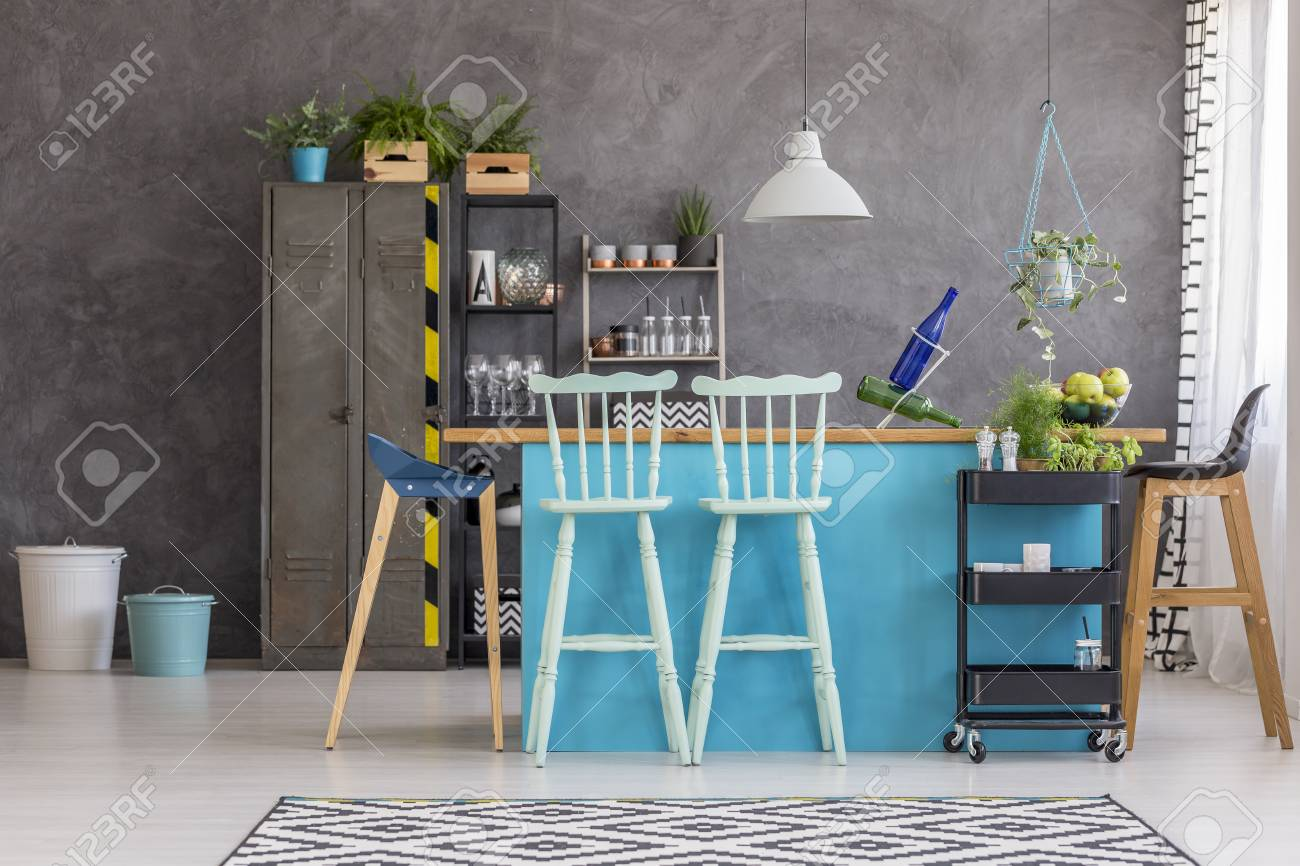 Picture of: White Lamp Above Kitchen Island With Blue Bar Stools In Interior Stock Photo Picture And Royalty Free Image Image 97990234