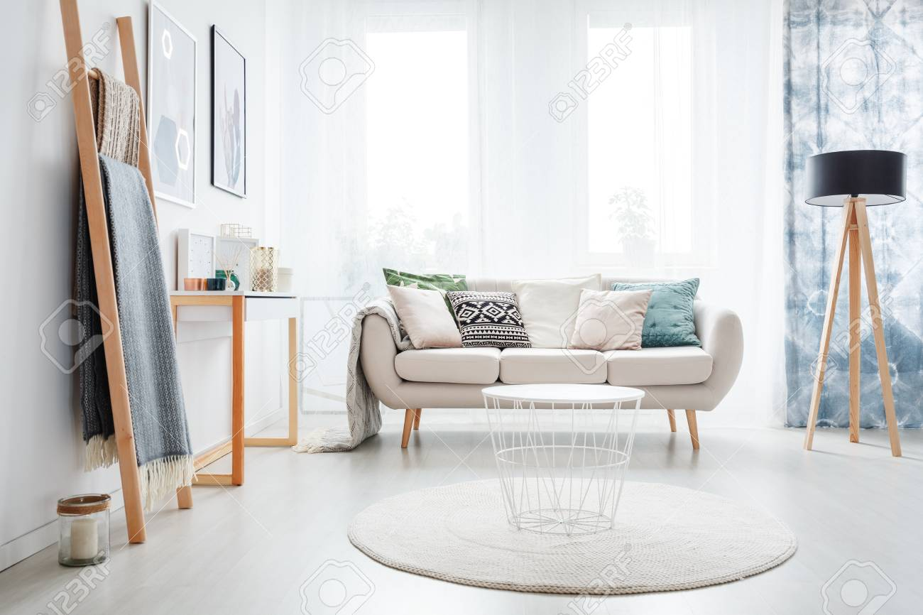 White Round Carpet In Bright Living Room With Lamp And Ladder