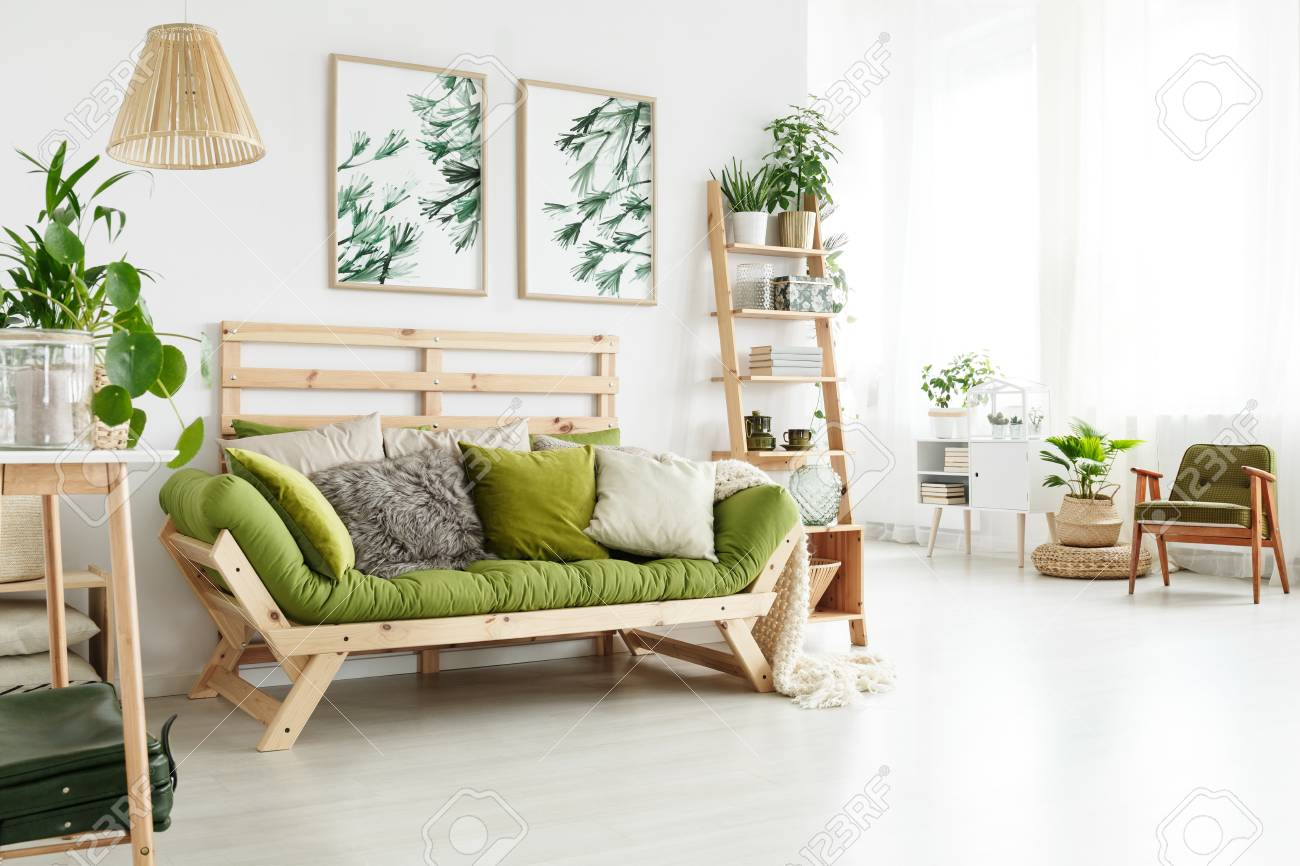 Green Wooden Sofa With Many Cushions Standing In Bright Living
