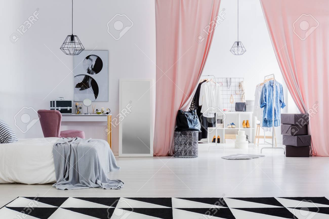 Dressing room with pink curtains connected with white bedroom