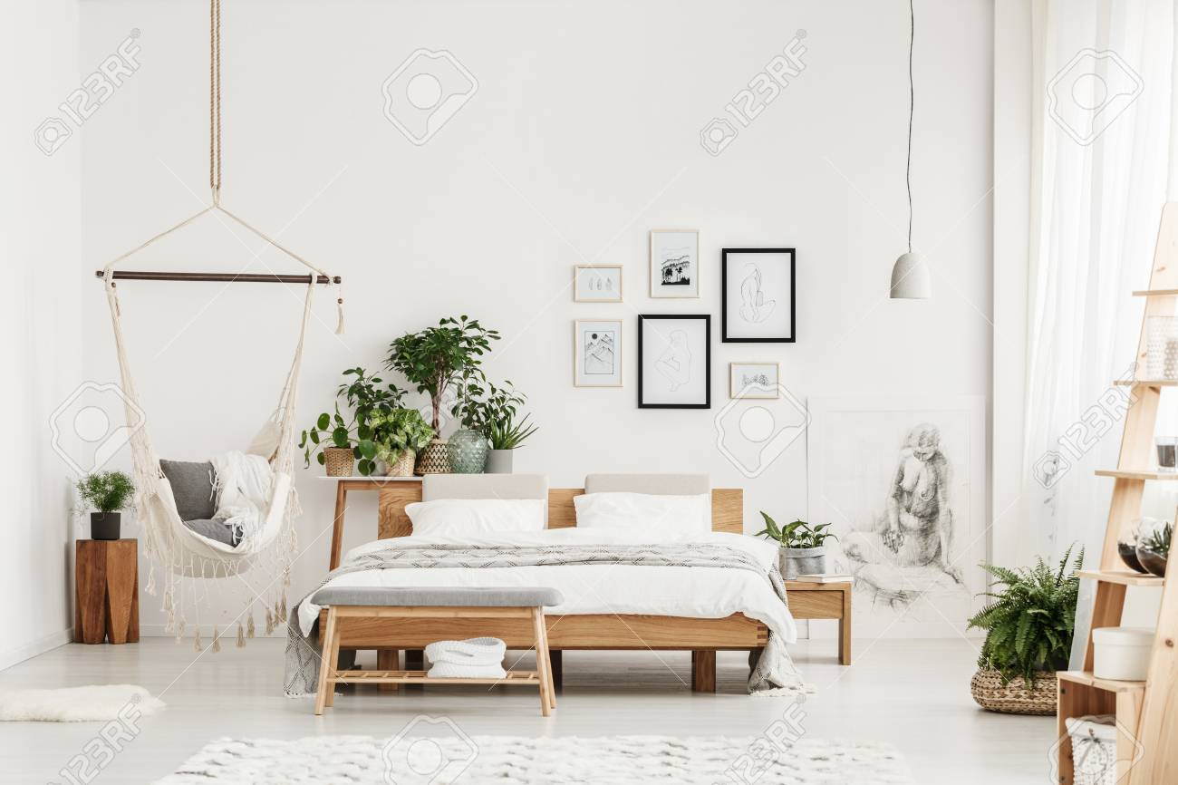 Wooden Bench And King Size Bed In Spacious White Bedroom Interior