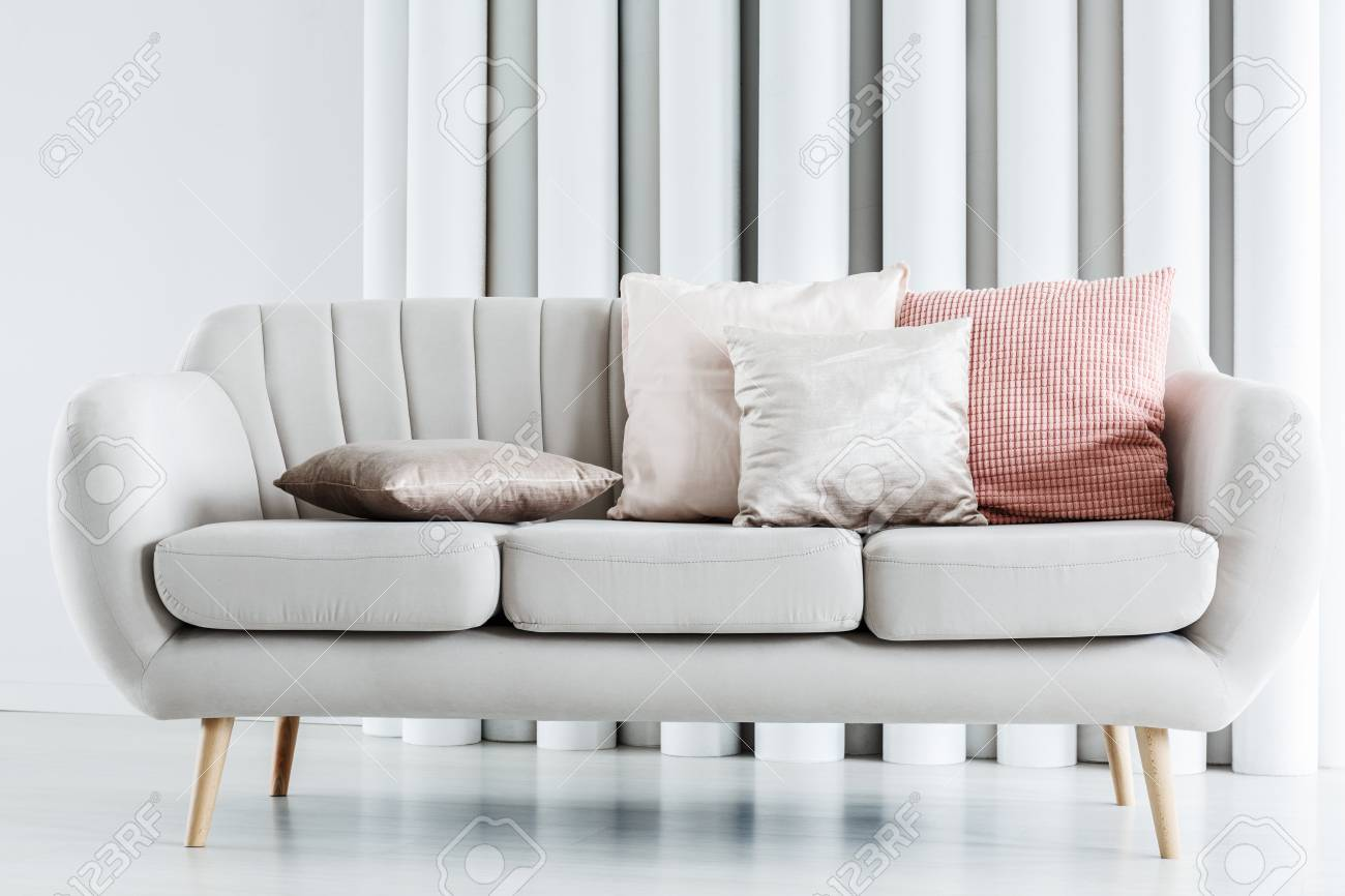 Close-up Photo Of Bright Grey Couch With Silver And Pink Cushions Stock Photo, Picture And Royalty Free Image. Image 97990600.