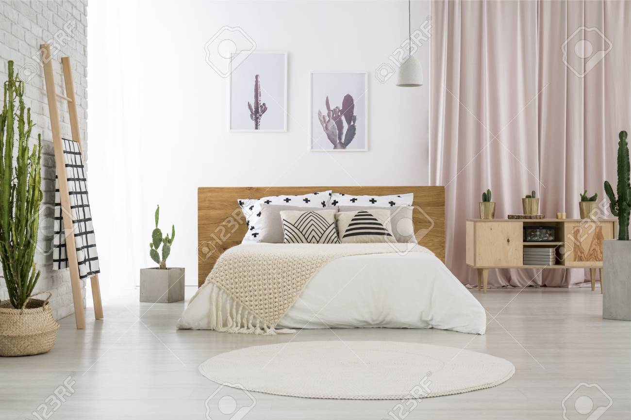 White round carpet in bright bedroom with cactus motif and patterned..