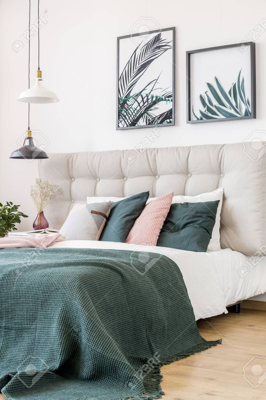 Close Up Of Pink And Green Pillows On Bed In Floral Bedroom Interior Stock Photo Picture And Royalty Free Image Image 92794289